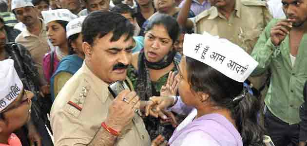 AAP volunteers protest against police inaction in a rape case in Delhi.