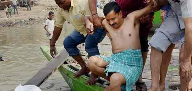 AAP chief Arvind Kejriwal takes a holy dip as he arrives in Varanasi.