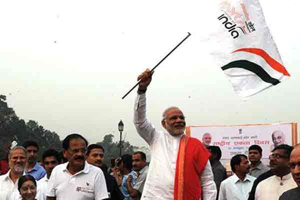 Narendra Modi flags off 'Run For Unity' on the death anniversary of Sardar Vallabhbhai Patel in Delhi.
