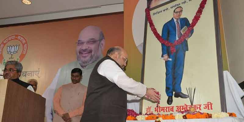 BJP chief Amit Shah paysfloral tribute to late Dr B R Ambedkar.